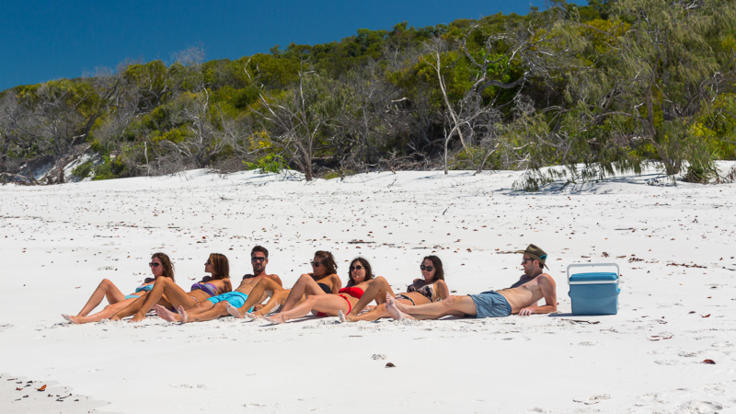 Relax with new friends in the Whitsundays on Whitehaven Beach