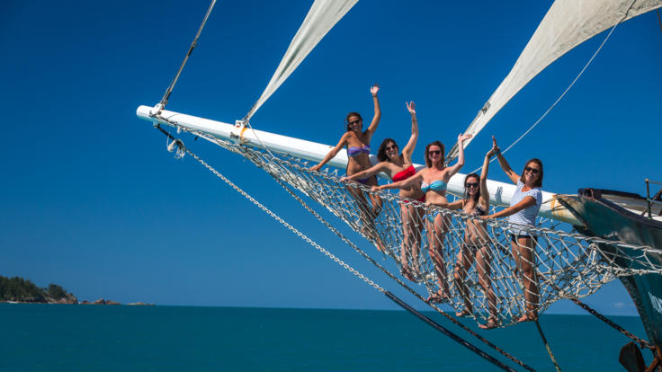 Girls boom netting on our 2 day 2 night Whitsundays sailing tour