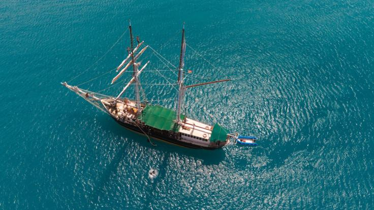Aerial view of our charter sailing boat in the Whitsunday Islands on the Great Barrier Reef
