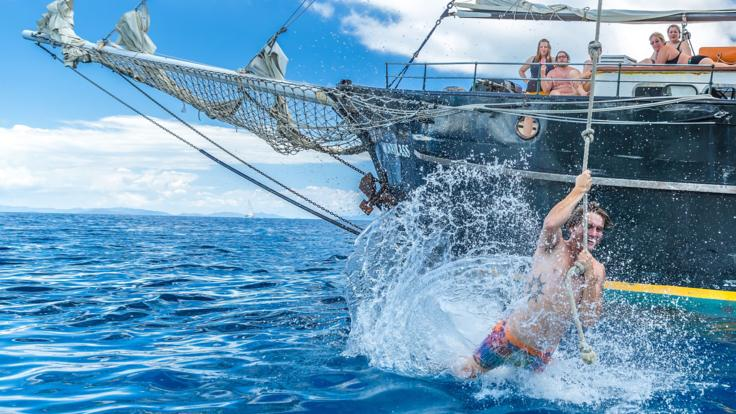 Try our Tarzan swing into the ocean on our Whitsundays sailing tour