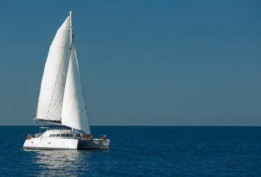 Sails set and cruising the Great Barrier Reef in style from Airlie Beach