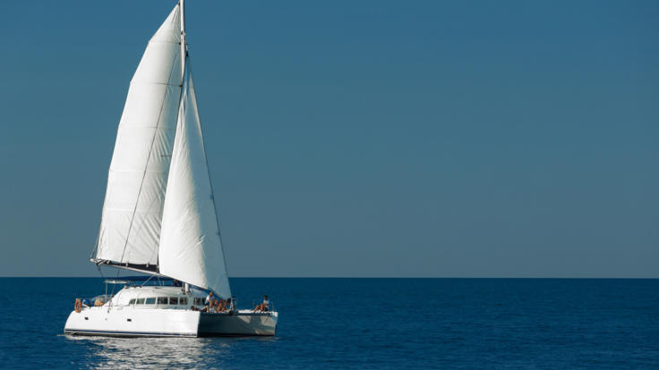 Whitsunday Yacht Charter - Sails set on the Great Barrier Reef from Airlie Beach