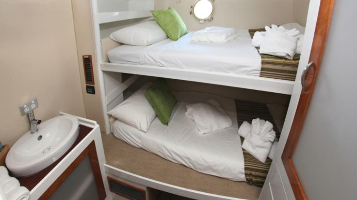 Sleep in air conditioned comfort in your twin share cabin