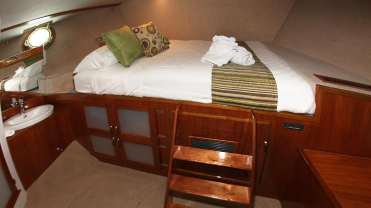 Sleep in air conditioned comfort in your ensuited queen cabin