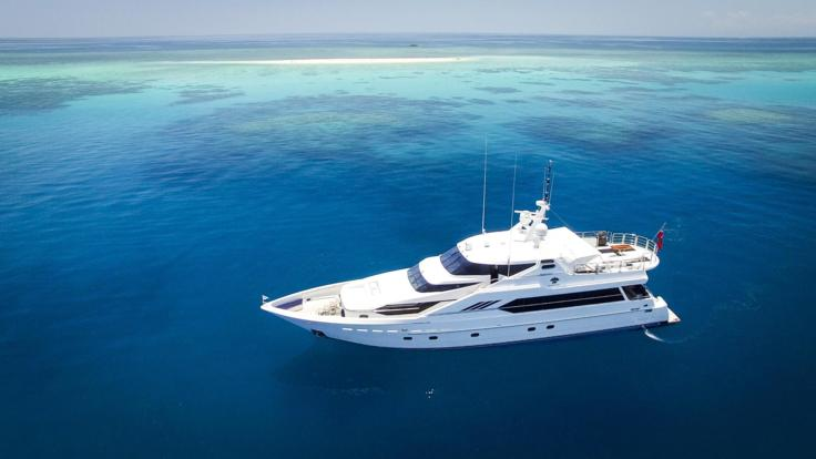 Aerial view of our Superyacht on the Great Barrier Reef in Australia
