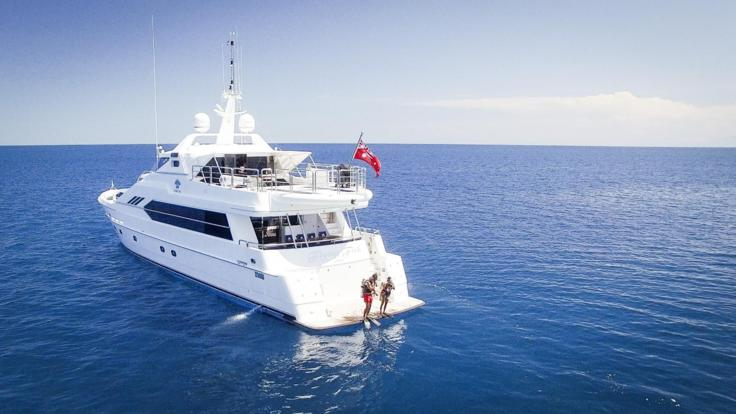Scuba diving from the rear deck of the Superyacht on the Great Barrier Reef
