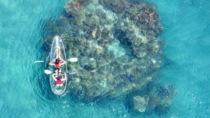 Kayaking on our Frankland Islands Great Barrier Reef tour
