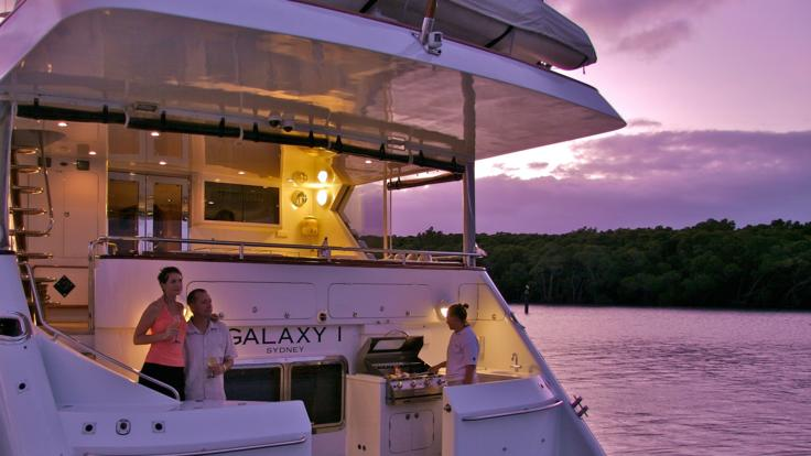 Enjoying the stunning view onboard Great Barrier Reef luxury private charter yacht