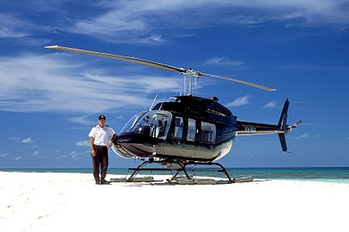 Port Douglas Helicopter Flights: Experienced pilot on Sand Cay