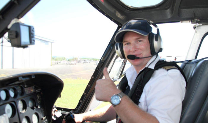 Friendly helicopter pilot ready to take you on a scenic flight from Port Douglas and Cairns