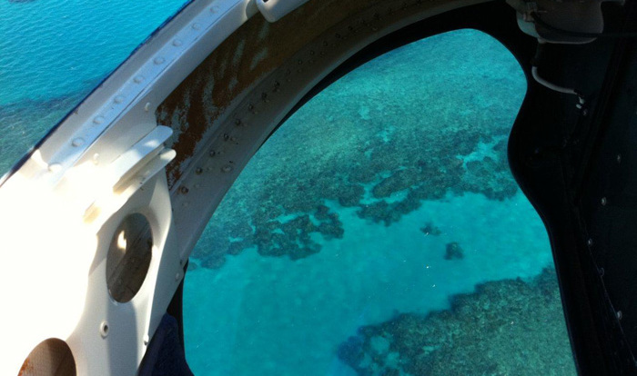 Aerial view of the Great Barrier Reef from helicopter in Cairns