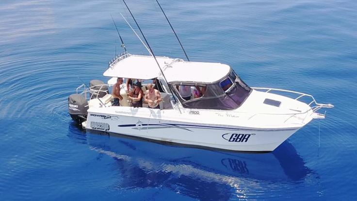 Aerial View of Cairns Private Charter Fishing Boat on the Great Barrier Reef in Australia