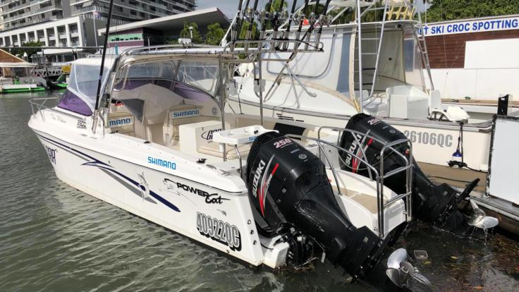 Side view of our 31foot Private Charter Powercat in Cairns on the Great Barrier Reef