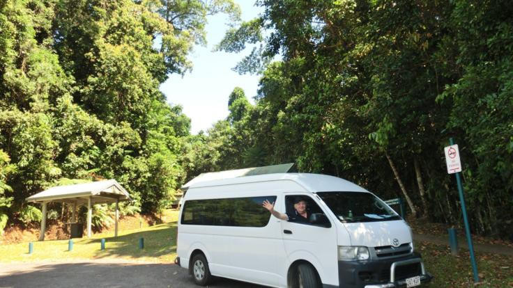Modern air-conditioned tour vehicle in in the rainforest