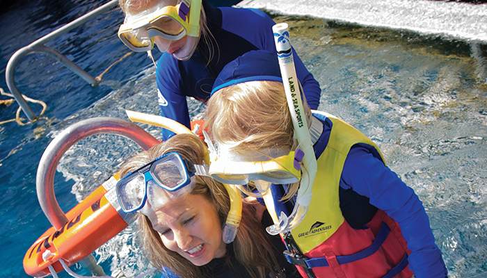 Family snorkelling the Great Barrier Reef
