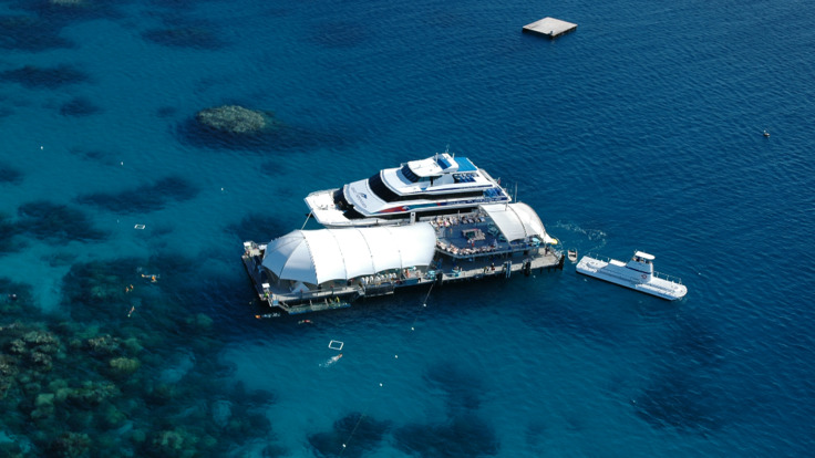 Aerial views of the Great Barrier Reef tour platform below