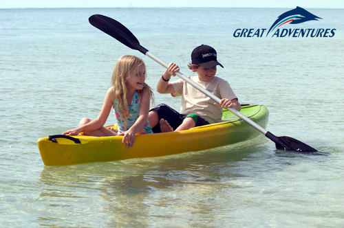 Children kayaking at Green Island on the Great Barrier Reef
