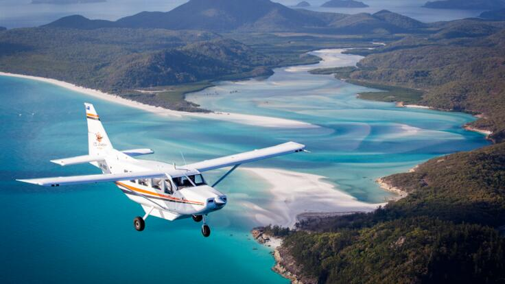 Scenic flight over the Great Barrier Reef & Whitehaven Beach and Heart Reef in Australia