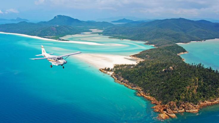 Scenic flight in fixed wing aircraft over Hill Inlet & Whitehaven Beach