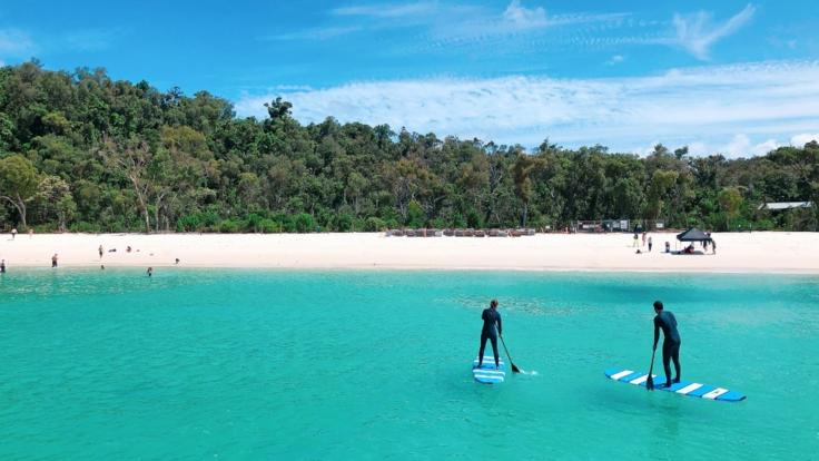 Ride our stand up paddle boards around the reef in the Whitsundays