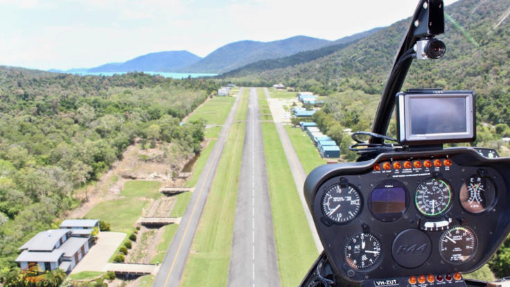 View from seat of Helicopter landing at Airlie Beach in the Whitsundays - Great Barrier Reef