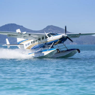 Seaplane landing at Whitehaven Beach Whitsundays - Great Barrier Reef