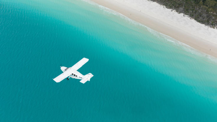 Fly low over Whitehaven Beach on your Whitsunday scenic flight