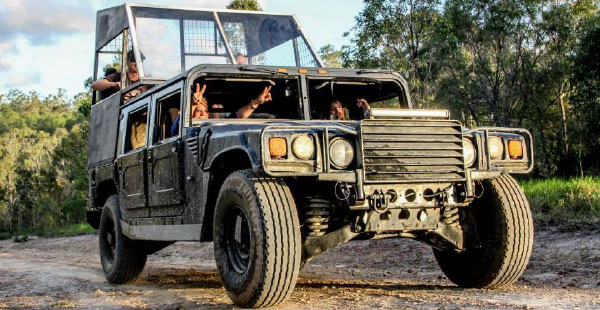Strap yourself in for the reckless ride of your life in a Hummer in Kuranda