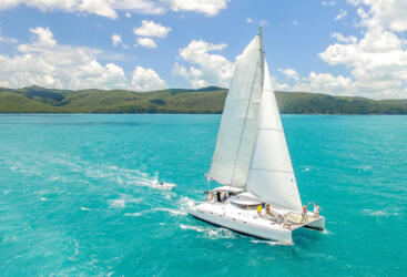 Yacht Charters Airlie Beach - Catamaran Under Sail Great Barrier Reef