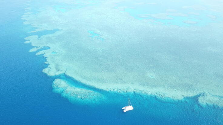 Port Douglas Yacht Charters - Aerial View Luxuty Yacht at Anchor Great Barrier Reef