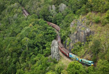 Return aboard the Kuranda Train and Scenic Rail to Cairns