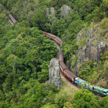 Return aboard the Kuranda Scenic Rail to Cairns