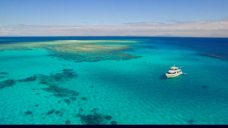 Aerial view of Boat -Snorkel and Dive the outer Reef from Mission Beach