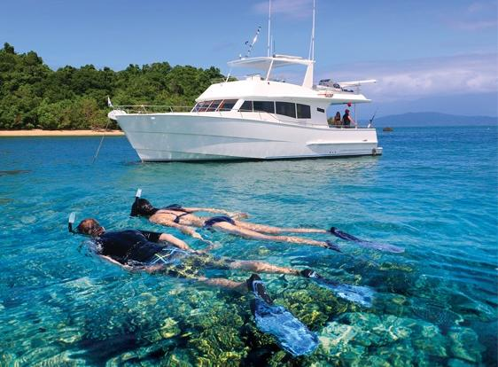 Snorkeling around Islands and Coral Cays on the Great Barrier Reef from Private Charter Boat