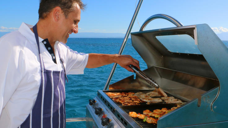 Your Private Charter Boat Crew Preparing a BBQ Lunch for Guests
