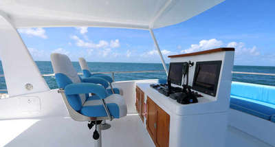 Port Douglas Luxury Boat Charters - Skippers Seat on Flybridge