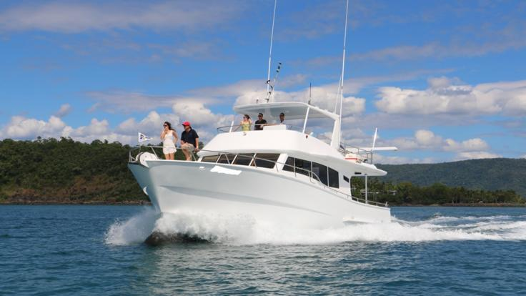 Ride the Bow of the Luxury Motor Boat on the Great Barrier Reef in Australia