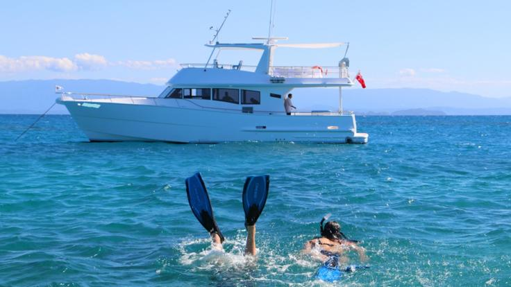 Private Charter Motor yacht at anchor on the Great Barrier Reef in Australia