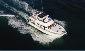 Aerial View of the Luxury 54 Foot Motor Yacht on the Great Barrier Reef in Australia