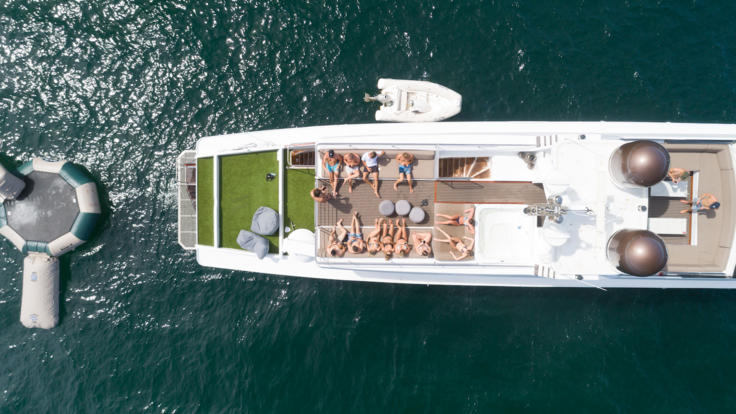 Luxury Superyacht Charter | Whitsundays | Relax on deck or enjoy the in water activities