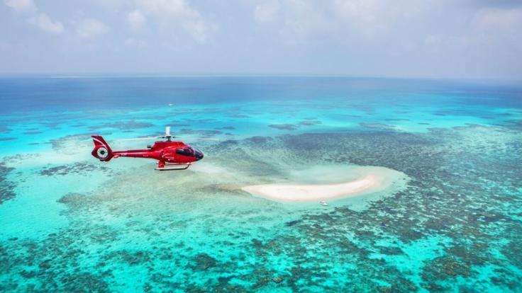Helicopter scenic flight over a sand cay on the Great Barrier Reef