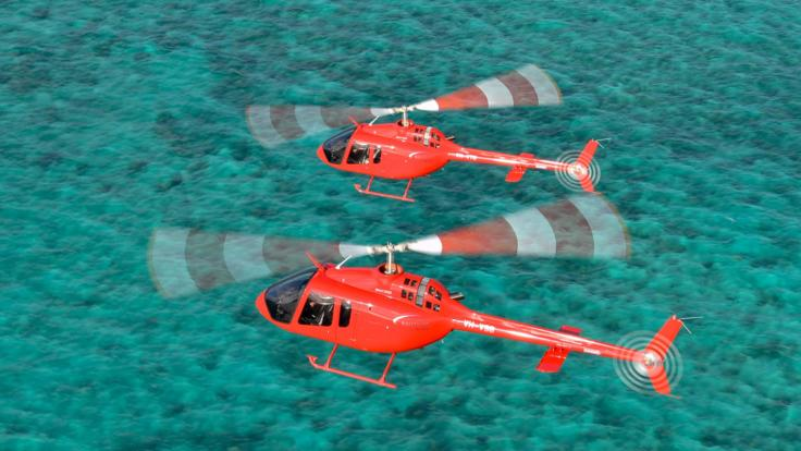 Two helicopters on scenic flights on the Great Barrier Reef in Australia