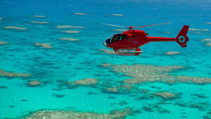 Helicopter scenic flight over the Great Barrier Reef in Australia