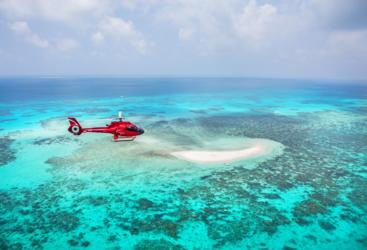Elegant coral surrounding a sandy cay on Great Barrier Reef scenic helicopter flight