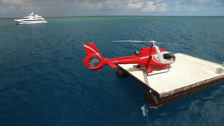 Helicopter on reef platform on the Great Barrier Reef in Cairns