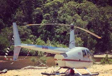 Helicopter at a remote fishing hole in Cairns