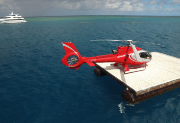 Helicopter on heli pad on the Great Barrier Reef in Australia