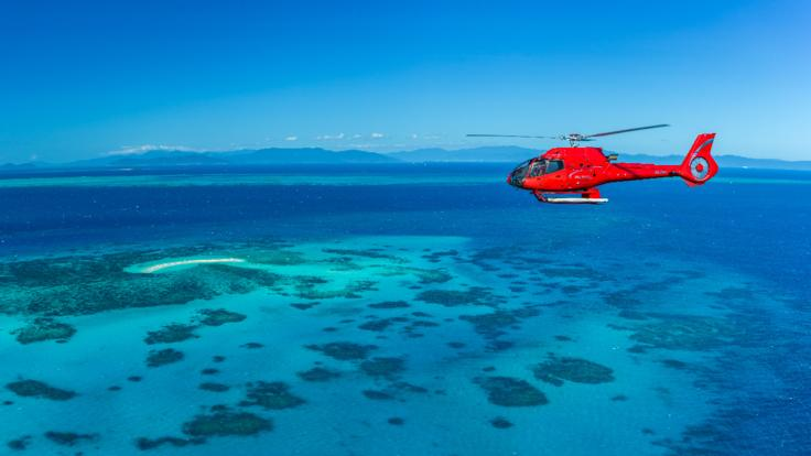 Aerial view of helicopter flying over the Great Barrier Reef in Australia