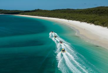 Aerial view of our 4 high speed ocean rafting boats at Whitehaven Beach in the Whitsundays