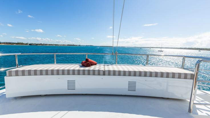Bask in the sun on luxury superyacht on the Great Barrier Reef.